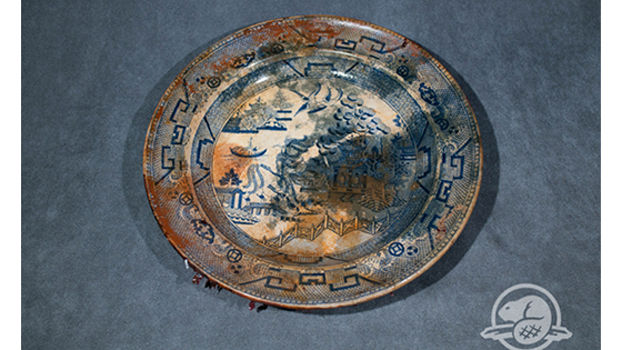 "On the lower deck of Erebus, archaeologists from Parks Canada recovered several ceramic plates, all British-made in the style of more expensive Chinese porcelain. This one's blue willow pattern was the most common and affordable print used in Europe and North America in the 19th century. Researchers believe that they might have been stored in a cupboard next to the ship's galley. The presence of the plates confirms Inuit accounts from the late 19th century, which reported a deserted ship trapped in ice containing ""spoons, knives, forks, tin plates, and china plates."" (Parks Canada)"