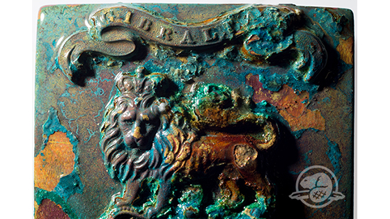 On the forward port side of Erebus, archaeologists found a number of artifacts, including a sword hilt and uniform buttons, that would have been issued to members of the British Royal Navy and Royal Marines. This shoulder belt plate, made of copper alloy and probably once gilded, had been issued to one of the 13 Royal Marines from the Woolwich Division that sailed on the expedition. (Parks Canada)