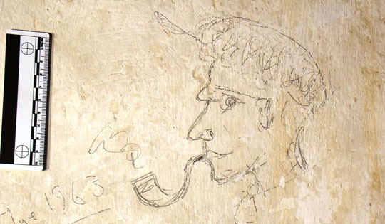 An army of servants and groundskeepers kept Knole House running for centuries, and many left their marks on the home. In narrow attic spaces, archaeologists found graffiti they left behind, including this sketch dating to 1963. (Courtesy National Trust)