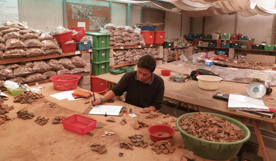 Graduate student Jorge Méndez records freshly excavated pottery sherds at the excavation's on-site laboratory. Most were deliberately smashed in antiquity—hinting at abrupt cultural or political change. (Roger Atwood)
