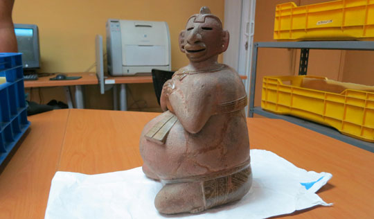 A two-piece incense burner—the upper torso lifts off—would have been used in ceremonies in which shamans divined messages from smoke.  It sits in storage at Guatemala's National Museum of Archaeology and Ethnography. (Roger Atwood)