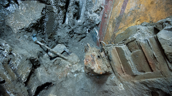 Iron implements are embedded in volcanic ash close to the eastern wall of the triclinium. Archaeologists believe they are tools that were being used to restore the complex immediately before the eruption of Mt. Vesuvius. (Marco Merola)