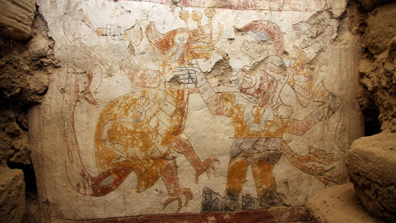 This mythological scene known from iconography on ceramics depicts a battle between the Moche mythological hero Ai-Apaec (right) and a Strombus monster (left) whose shell is adorned with a two-headed serpent. It had never been seen before in a mural or in polychrome until 2010 when it was uncovered.