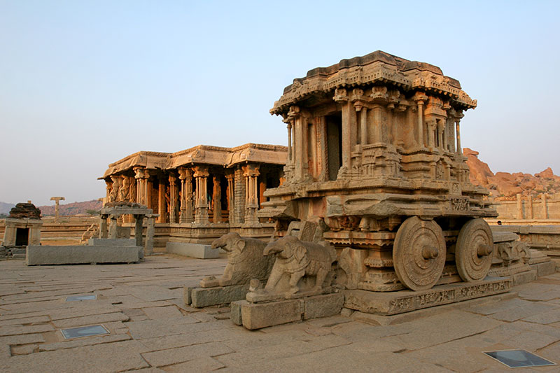 A shrine, in the form of a wheeled chariot, to Garuda, a mythical bird-like creature, in Hampi's Vitthala Temple complex